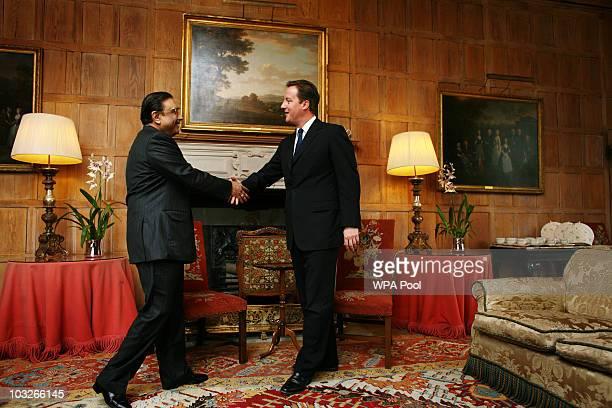 British Prime Minister David Cameron greets Pakistan's President Asif Ali Zardari on August 6, 2010 at Chequers near Princes Risborough, England....