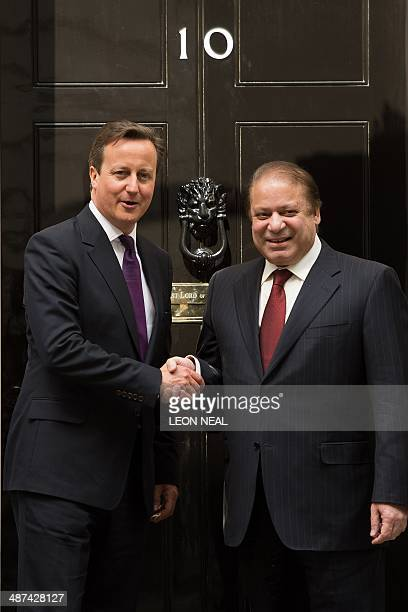 British Prime Minister David Cameron greets Pakistan's Prime Minister Nawaz Sharif outside 10 Downing Street in central London on April 30 2014...