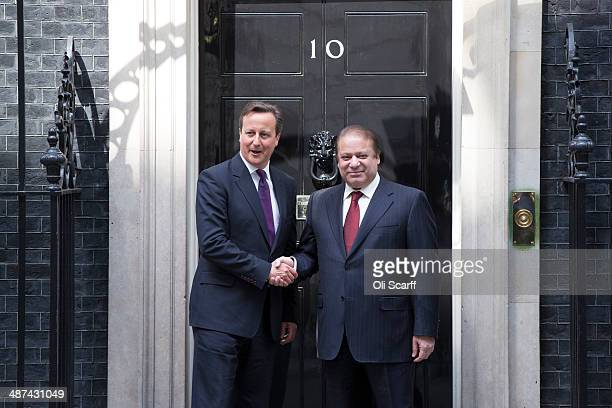 British Prime Minister David Cameron greets Prime Minister of Pakistan Muhammad Nawaz Sharif in Downing Street on April 30 2014 in London England...