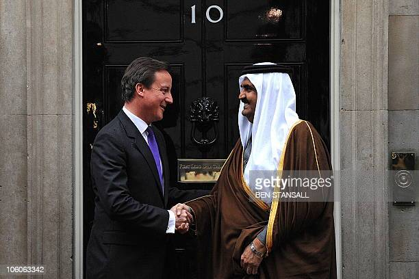 British Prime Minister David Cameron greets Qatar's emir Sheikh Hamad bin Khalifa alThani on the steps of 10 Downing Street in central London on...