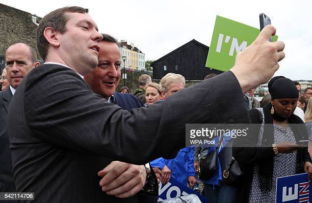 British Prime Minister David Cameron greets supporters after addressing proEU 'Vote Remain' supporters at rally on June 22 2016 in Bristol United...