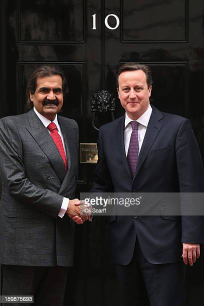 British Prime Minister David Cameron greets the Emir of Qatar Sheikh Hamad bin Khalifa Al Thani at Number 10 Downing Street on January 22 2013 in...