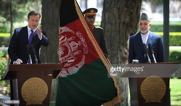 British Prime Minister David Cameron holds a press conference with Afghan President Hamid Karzai before arriving at the Presidential Palace on July...