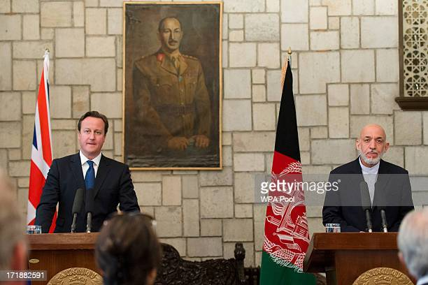 British Prime Minister David Cameron holds a press conference with President of Afghanistan Hamid Karzai in the Presidential Palace on June 29, 2013...