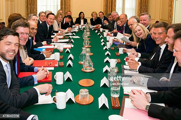 British Prime Minister David Cameron hosts the first cabinet meeting with his new cabinet in Downing Street on May 12, 2015 in London, England....