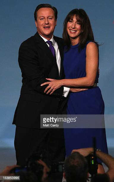 British Prime Minister David Cameron hugs his wife Samantha after he delivered his speech to delegates on the last day of the Conservative party...