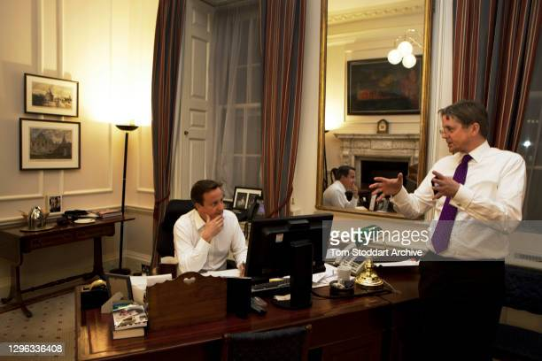 British Prime Minister David Cameron in his Downing Street office in discussion with Cabinet Secretary Sir Jeremy Heywood , London, England, October...