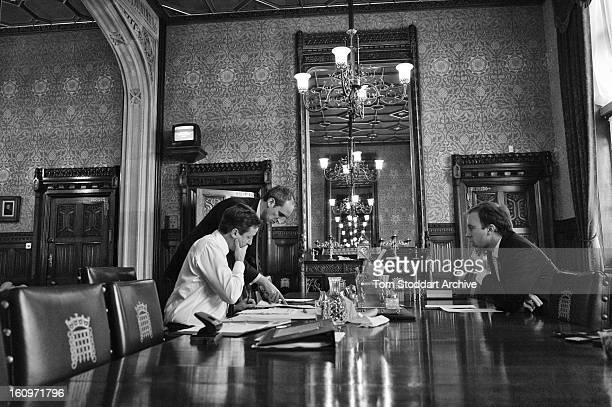 British Prime Minister David Cameron in his House of Commons office photographed with staff working on his notes before going into the Chamber to...