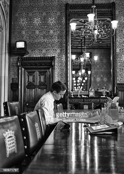 British Prime Minister David Cameron in his House of Commons office photographed working on his notes before going into the Chamber to face Labour...