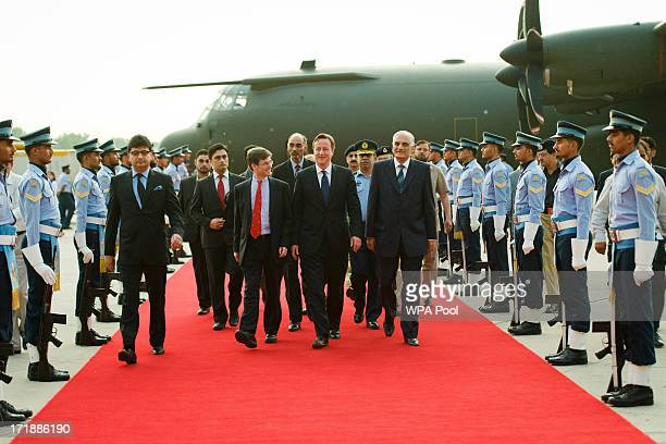 British Prime Minister David Cameron inspects a guard of honour as he arrives in at the Chaklala Airbase on June 29 2013 near Islamabad Pakistan...