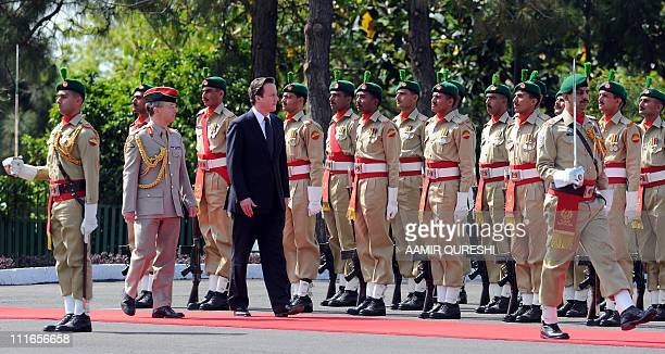 British Prime Minister David Cameron inspects a Guard of Honour of Pakistani troops during a welcoming ceremony at the Prime Minister House in...