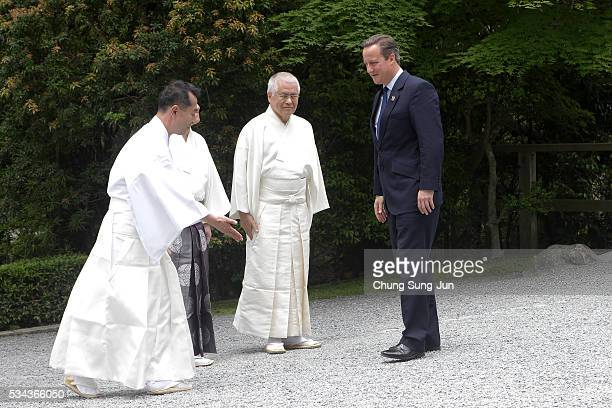 British Prime Minister David Cameron is greet by Shinto priests as he visit the IseJingu Shrine on May 26 2016 in Ise Japan In the twoday summit the...