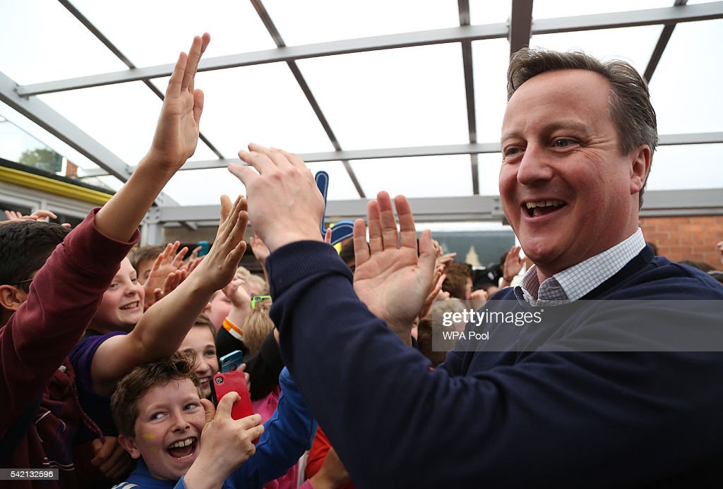 British Prime Minister David Cameron is greeted by children as he arrives to visit The Warriner School, a secondary school in Bloxham near Banbury on June 22, 2016 in Banbury, United Kingdom. The final day of campaigning continues across the UK as the country prepares to go to the polls on June 23rd to decide whether Britain should remain or leave the European Union.