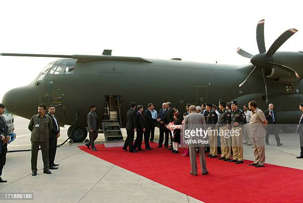 British Prime Minister David Cameron is greeted by dignitaries as he arrives in at the Chaklala Airbase on June 29 2013 near Islamabad Pakistan...