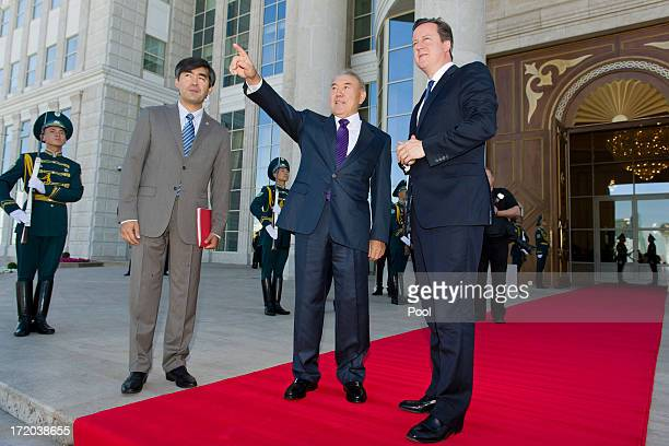 British Prime Minister David Cameron is greeted by Kazakhstan President Nursultan Nazarbayev as he arrives at the Presidential Palace on July 1 2013...