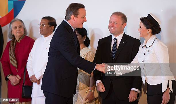 British Prime Minister David Cameron is greeted by Malta Prime Minister Joseph Muscat and his wife Michelle as he arrives at CHOGM opening ceremony...