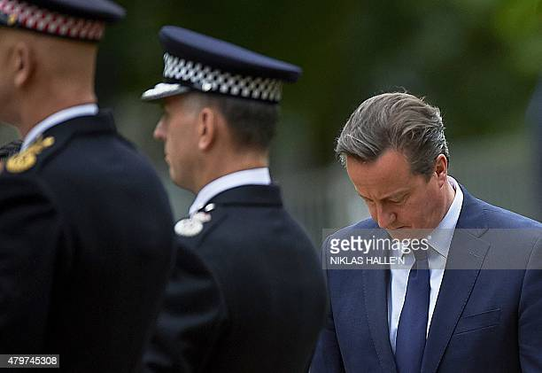 British Prime Minister David Cameron is pictured as he takes part in a wreath laying ceremony in London's Hyde Park on July 7 in memory of the 52...