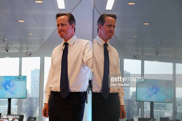 British Prime Minister David Cameron is reflected in a flatscreen TV as he takes questions during a QA session at The Times offices on July 14 2015...