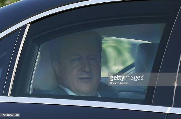 British Prime Minister David Cameron is seen traveling in a car in Shima, Mie Prefecture, on May 27 after attending a two-day Group of Seven summit.