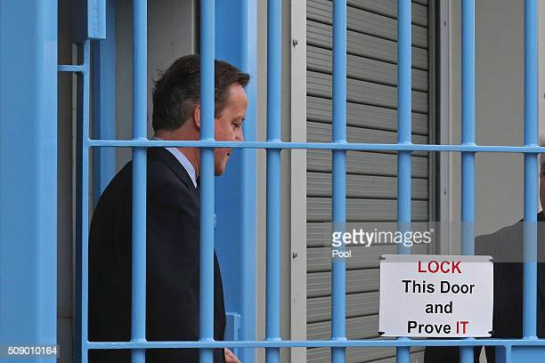 British Prime Minister David Cameron is shown around HM Prison Onley in Rugby central England on February 8 2016 Cameron is set to announce the...