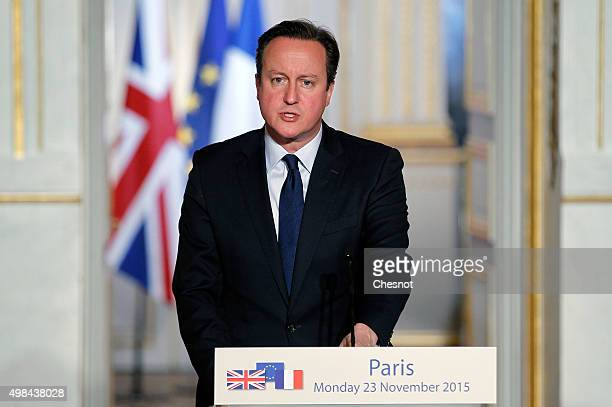 British Prime Minister David Cameron issues a statement during a press conference with French President Francois Hollande at the Elysee Palace on...