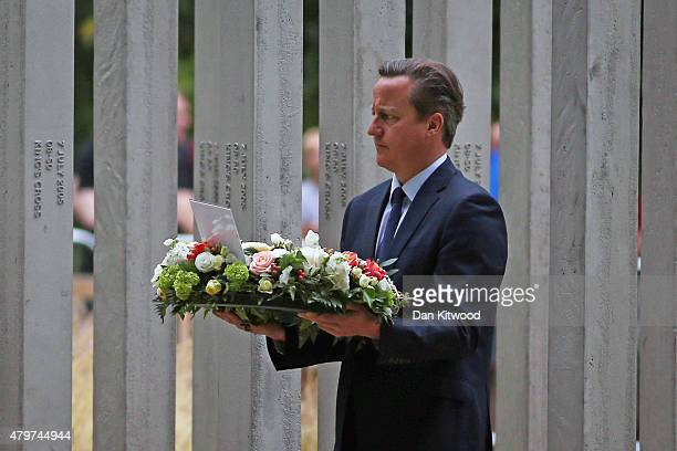 British Prime Minister David Cameron lays a wreath during a ceremony at the memorial to the victims of the July 7 2005 London bombings in Hyde Park...