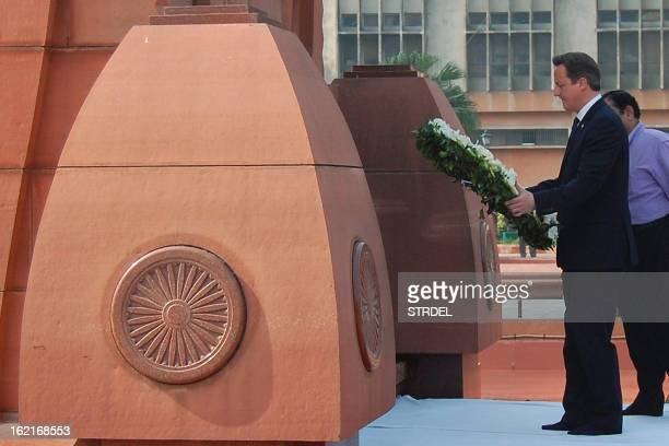 British Prime Minister David Cameron lays a wreath in tribute to the Jallianwala Bagh martyrs at the Jallian wala Bagh memorial in Amritsar on...