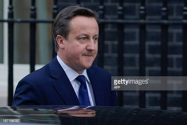 British Prime Minister David Cameron leaves 10 Downing Street in London on November 29 as he prepares to address parliament following the release of...