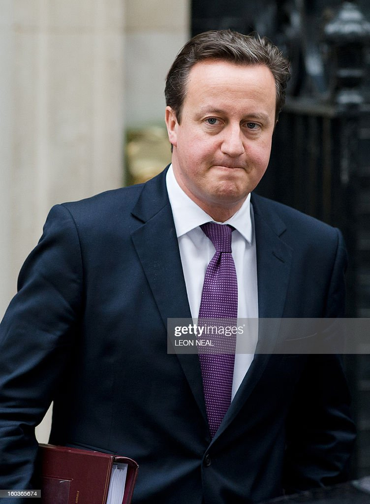 British Prime Minister David Cameron leaves 10 Downing Street in London, on January 30, 2013, as he prepares to address the weekly Prime Ministers Questions at the House of Commons. Cameron will head to Algeria on Wednesday for a two-day visit in the wake of the hostage crisis that left some 37 foreigners dead including several Britons, his office confirmed. AFP PHOTO/Leon Neal