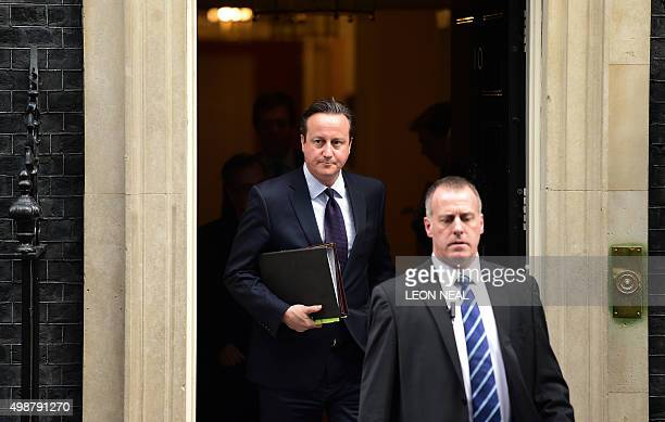 British Prime Minister David Cameron leaves 10 Downing Street in central London on November 26 bound for the Houses of Parliament where he made a...