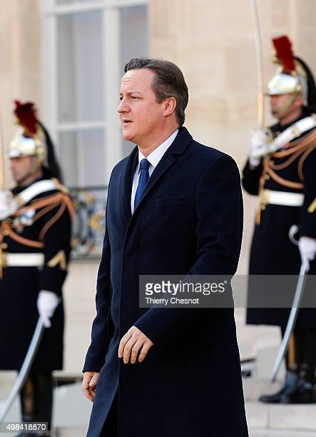 British Prime Minister David Cameron leaves after a meeting with French President Francois Hollande at the Elysee Presidential Palace on November 23...