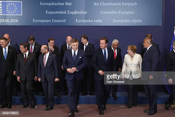 British Prime Minister David Cameron leaves after the group family photo with the European Council during a European Council Meeting at the Council...