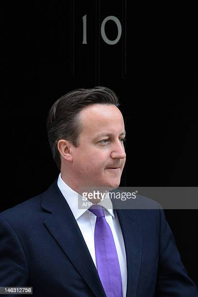British Prime Minister David Cameron leaves number 10 Downing Street in central London on June 14 2012 ahead of his appearance before the Leveson...