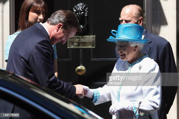British Prime Minister David Cameron leaves Number 10 Downing Street with Queen Elizabeth II on July 24 2012 in London England British Prime Minister...