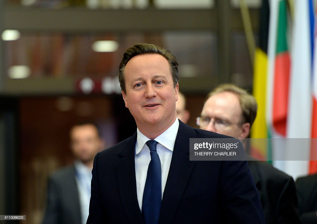 British Prime Minister David Cameron leaves the working dinner at the end of an European Union (EU) summit in Brussels, on February 19, 2016. European leaders sealed a deal with the UK after hours of haggling at a marathon summit, paving the way for a referendum on whether Britain will stay in the EU. The European Union's two top figures, Donald Tusk and Jean-Claude Juncker, presented its 28 leaders with draft proposals at a long-delayed dinner after hours of painstaking face-to-face talks on an issue that threatened place in the union. / AFP / THIERRY