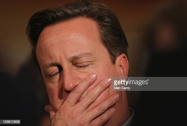 British Prime Minister David Cameron listens to Foreign Secretary William Hague deliver his speech at the Conservative party conference in the...