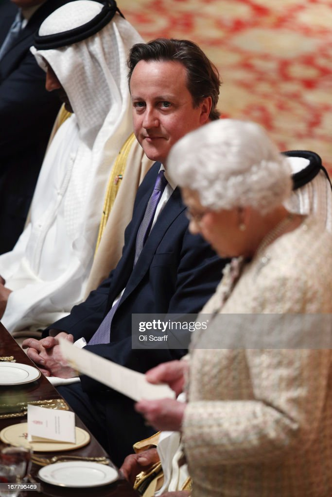 British Prime Minister David Cameron listens to Queen Elizabeth II deliver a speech at a State Luncheon for The President of the United Arab Emirates, His Highness Sheikh Khalifa bin Zayed Al Nahyan, in Windsor Castle on April 30, 2013 in Windsor, England. The President of the United Arab Emirates is paying a two-day State Visit to the United Kingdom, staying in Windsor Castle as the guest of Her Majesty The Queen from April 30, 2013 to May 1, 2013. Sheikh Khalifa will meet the British Prime Minister David Cameron tomorrow at his Downing Street residence.