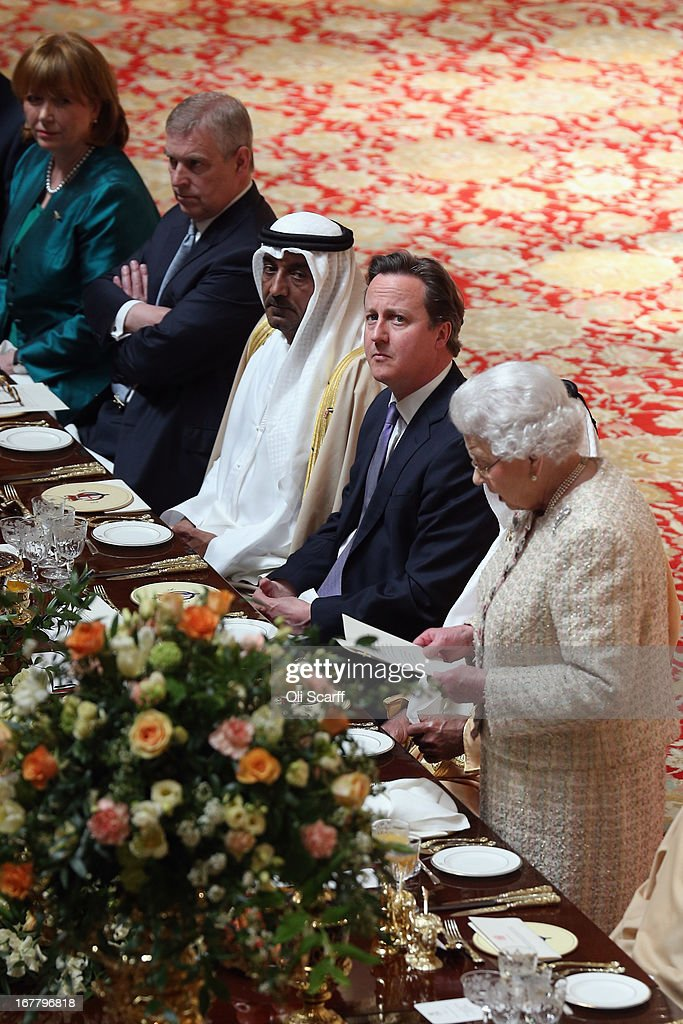 British Prime Minister David Cameron (2nd L) listens to Queen Elizabeth II (L) deliver a speech at a State Luncheon for The President of the United Arab Emirates, His Highness Sheikh Khalifa bin Zayed Al Nahyan, in Windsor Castle on April 30, 2013 in Windsor, England. The President of the United Arab Emirates is paying a two-day State Visit to the United Kingdom, staying in Windsor Castle as the guest of Her Majesty The Queen from April 30, 2013 to May 1, 2013. Sheikh Khalifa will meet the British Prime Minister David Cameron tomorrow at his Downing Street residence.