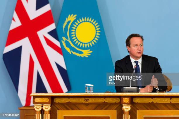 British Prime Minister David Cameron listens to questions during a joint press conference with President Nursultan Nazarbayev after signing a...