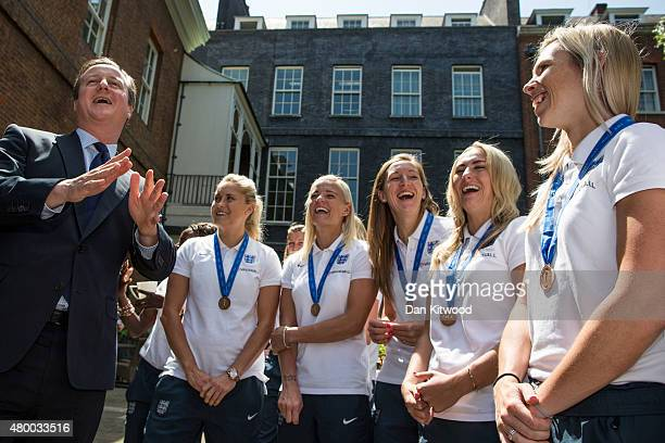 British Prime Minister David Cameron meets members of the England Women's Football team at 10 Downing Street on July 9 2015 in London England The...