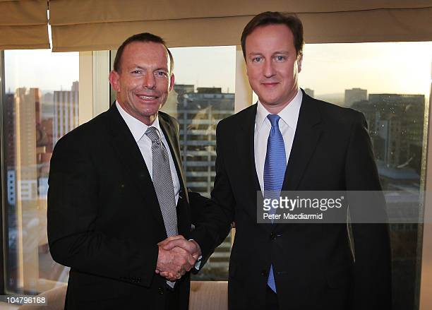 British Prime Minister David Cameron meets with Australian Oppostion Leader Tony Abbott at the Conservative Party Conference on October 5, 2010 in...