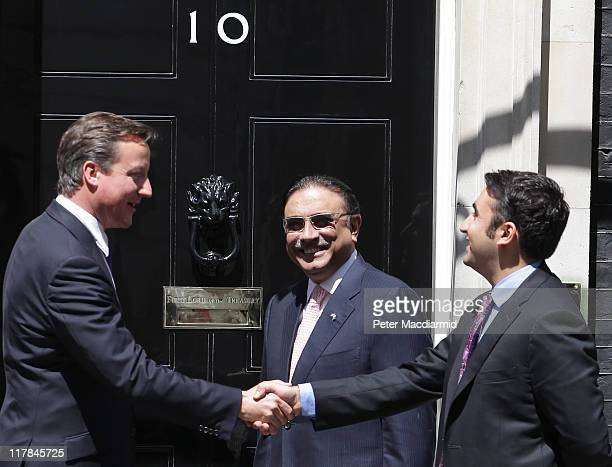 British Prime Minister David Cameron meets with Bilawal Bhutto as Pakistan's President Zardari looks on in Downing Street on July 1 2011 in London...