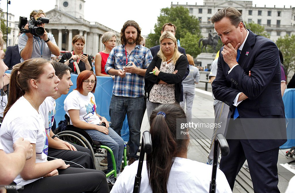 British Prime Minister David Cameron meets with flame ambassadors after the Olympic cauldron was lit for the Paralympic Games in Trafalgar Square on August 24, 2012 in London, England. The London 2012 Paralympic Games open on August 29, 2012 for 12 days.