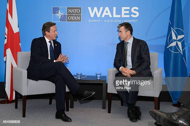 British Prime Minister David Cameron meets with NATO Secretary General Anders Fogh Rasmussen at the Celtic Manor Resort on September 3 2014 in...