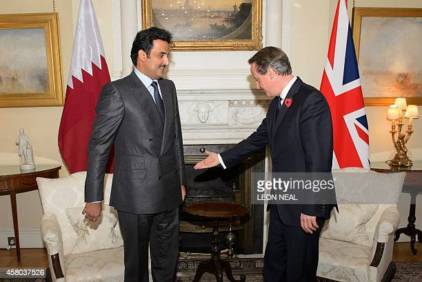 British Prime Minister David Cameron meets with the Emir of Qatar Sheikh Tamim Bin Hamad Al Thani inside 10 Downing Street in London on October 29...