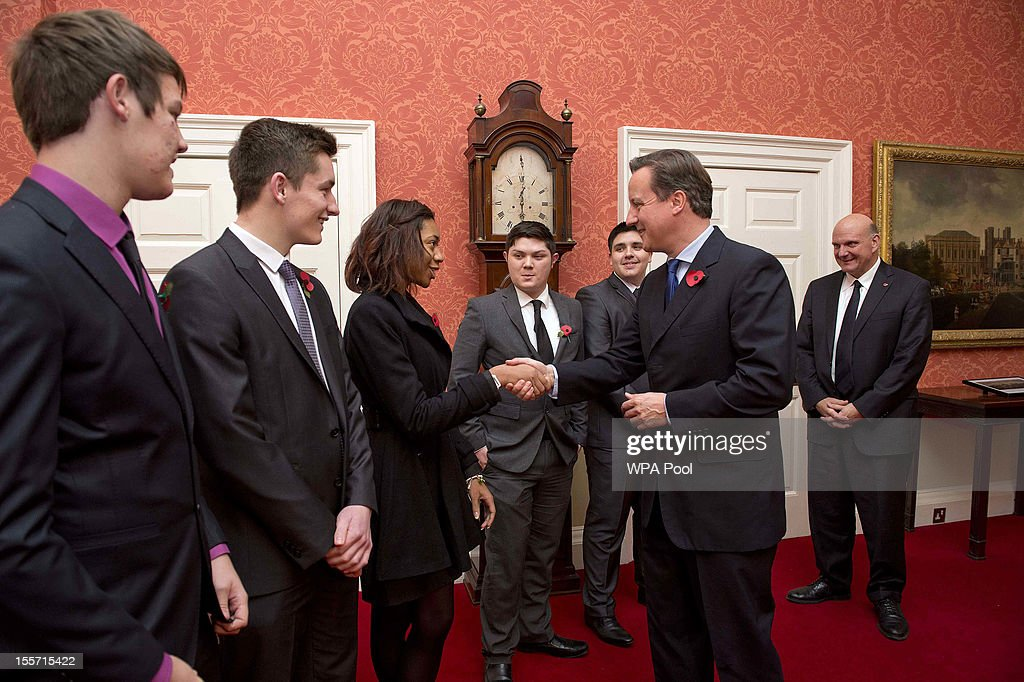 British Prime Minister David Cameron meets with young members of Microsoft's Get On programme and Microsoft CEO Steve Ballmer (R) at 10 Downing Street on November 7, 2012 in London, England. Microsoft is aiming to give 300,000 young unemployed people help with the skills and inspiration needed to gain their first job.