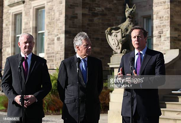 British Prime Minister David Cameron , Northern Ireland's First Minister Peter Robinson and deputy First Minister Martin McGuinness pose for...