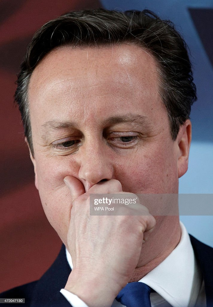 British Prime Minister David Cameron pauses as he delivers a speech at the Ambleside Sports Club on May 3, 2015 in Nuneaton, England. Britain goes to the polls in a General Election on May 7.