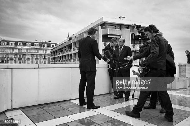 British Prime Minister David Cameron photographed being interviewed by the BBC's political editor Nick Robinson during the G20 Summit in Cannes France