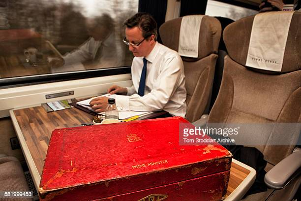 British Prime Minister David Cameron photographed on a train journey to Yorkshire during a day when Mr Cameron visited businesses and organisations...